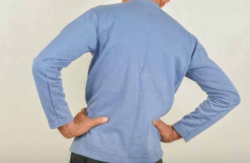 Dolor de espalda en hombres foto de archivo libre de regalías
