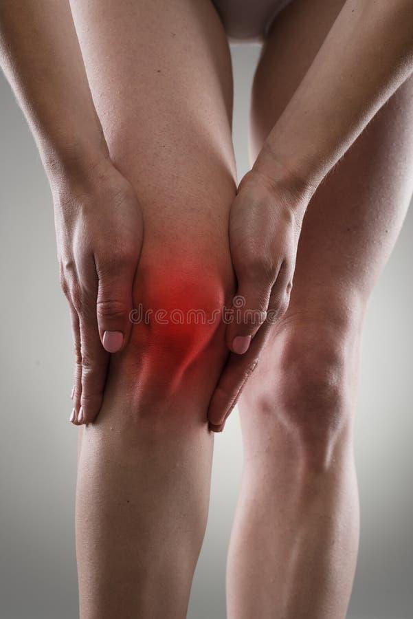 Dolor de la rodilla imagen de archivo