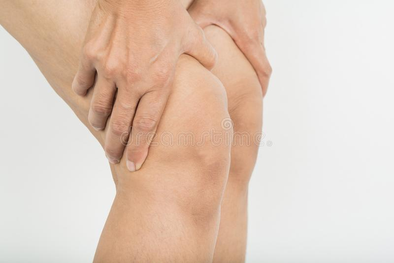 Dolor de la rodilla en mujer imagen de archivo