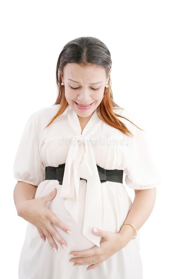 Dolor de la sensación de la mujer embarazada en ella detrás foto de archivo libre de regalías