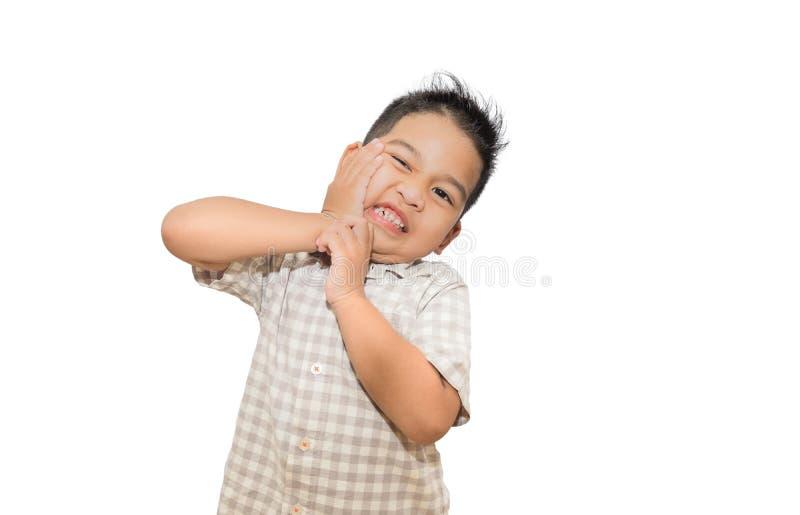 Dolor de muelas asi?tico del muchacho en el fondo blanco fotos de archivo