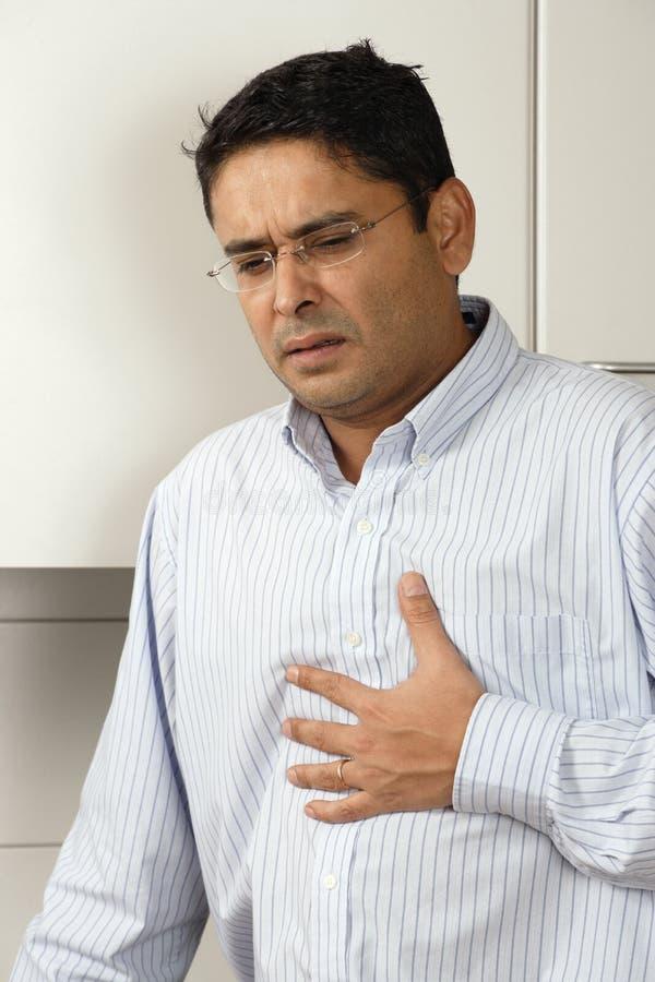 Dolor del ardor de estómago fotografía de archivo