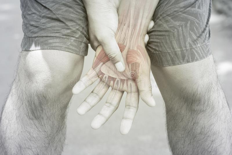 Dolor muscular de la mu?eca foto de archivo