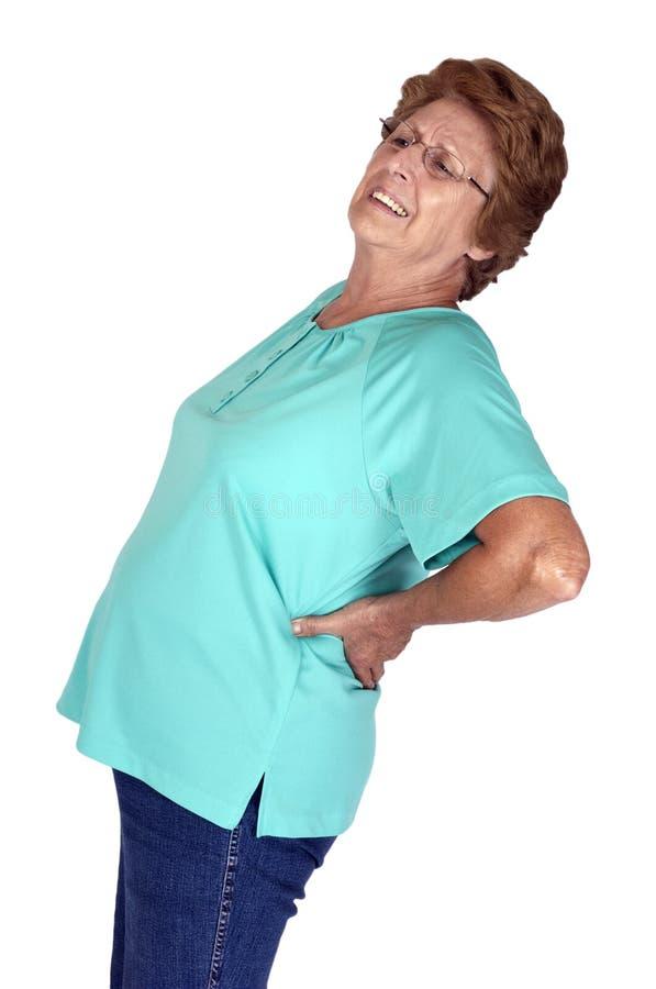 Dolor posterior y dolor de la mujer mayor madura aislados imagenes de archivo