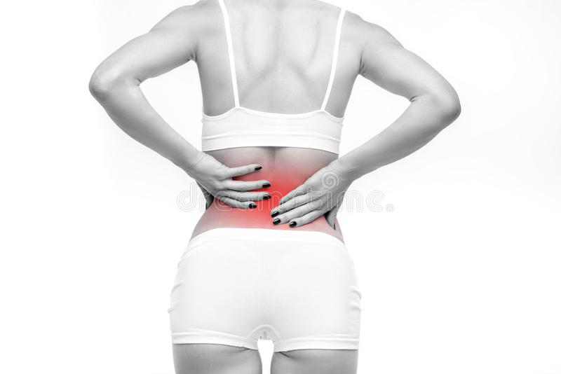 Dolor trasero o lumbar, persona femenina con dolor de espalda foto de archivo