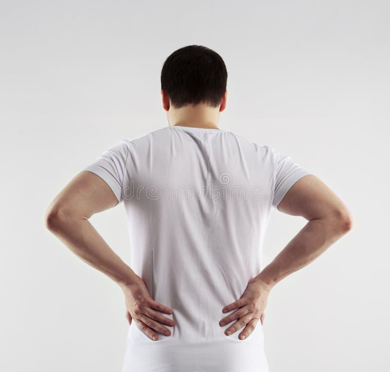 Dolore alla schiena dell'uomo immagini stock