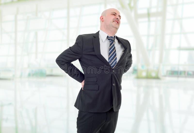 Dolore alla schiena dell'uomo d'affari immagini stock libere da diritti