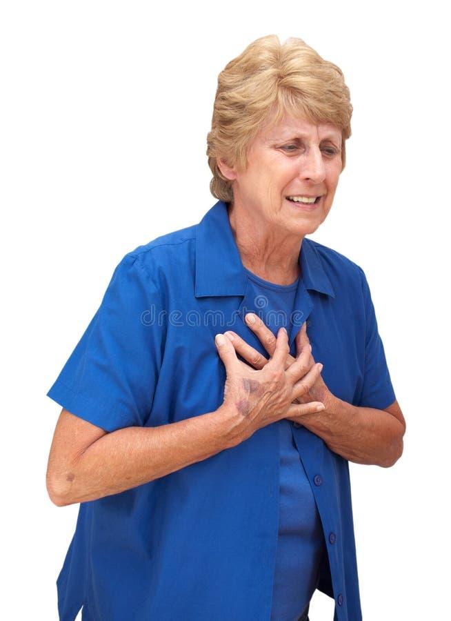 Dolores de pecho mayores maduros de la mujer aislados foto de archivo