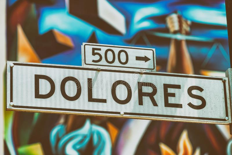 Dolores Street Road in San Francisco with blurred street art on. The background stock photography