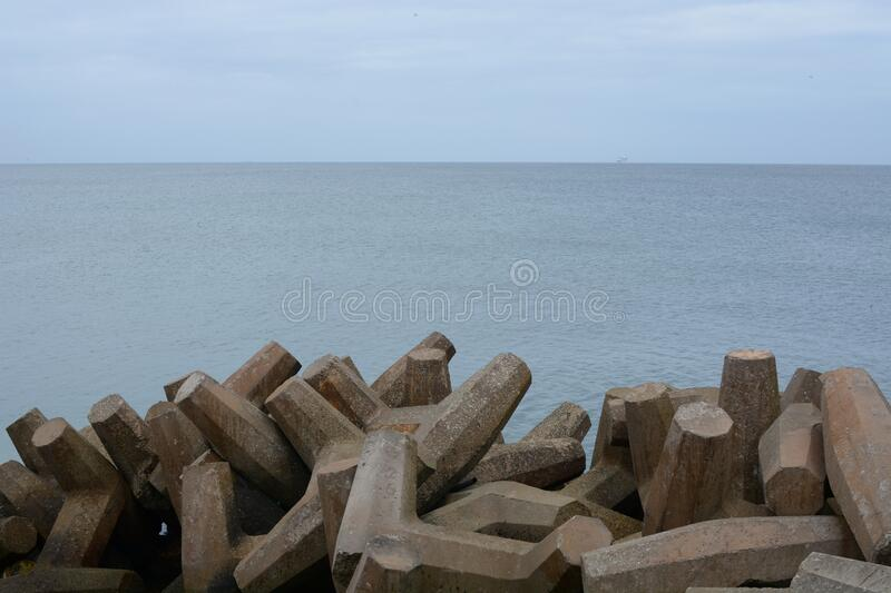 Barrier with view of ocean in background stock photography