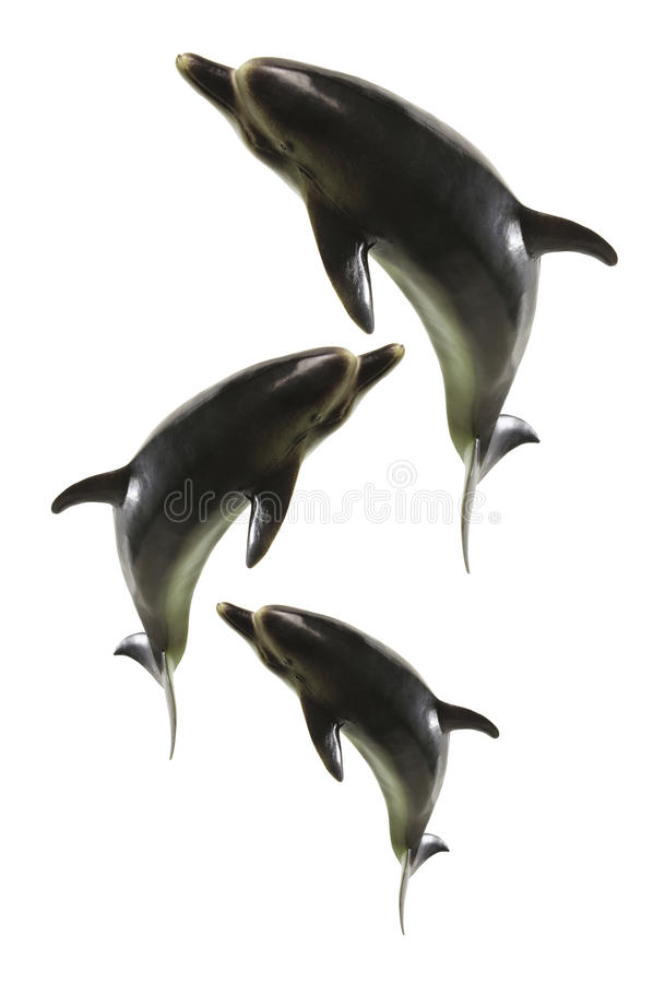 Dolphin Figurines. On White Background stock photography