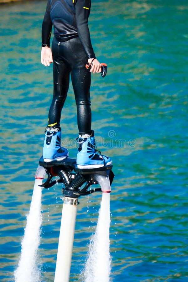 Dolphin style during a flyboard show. In the ionian sea on blur background royalty free stock photography