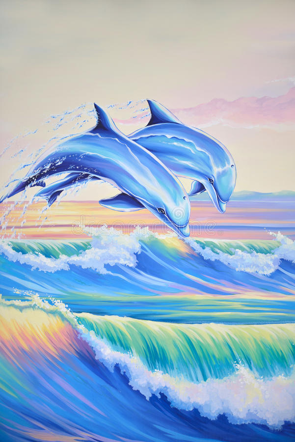Dolphins in the surf