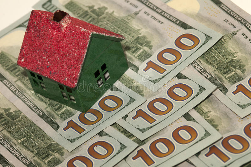 Dom i pieniądze obrazy stock