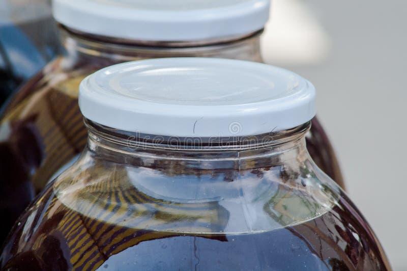 Dom konserwować sok w banku zdjęcie royalty free