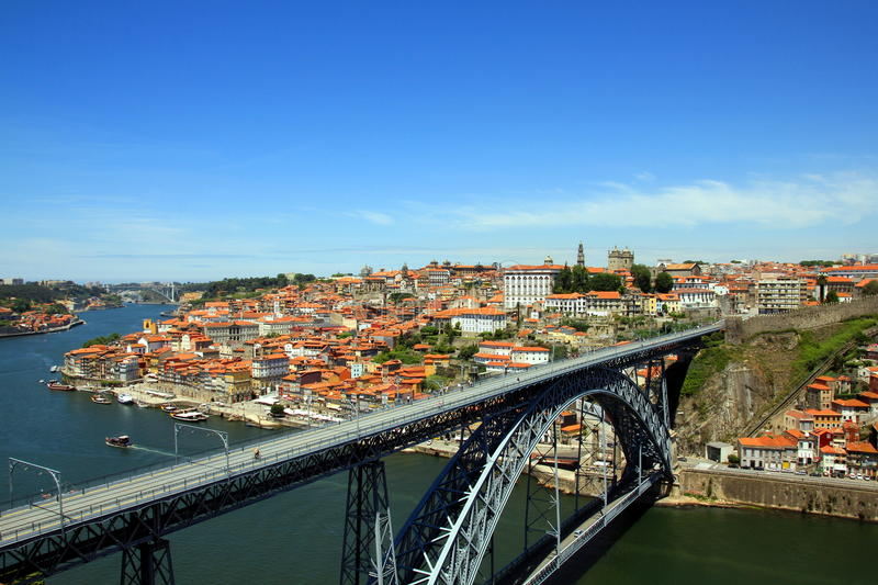 Dom Luís Bridge in Porto, Portugal. Dom Luís Bridge spanning the Douro river with the Ribeira, Torre dos Clérigos and the Porto Cathedral in the stock photography