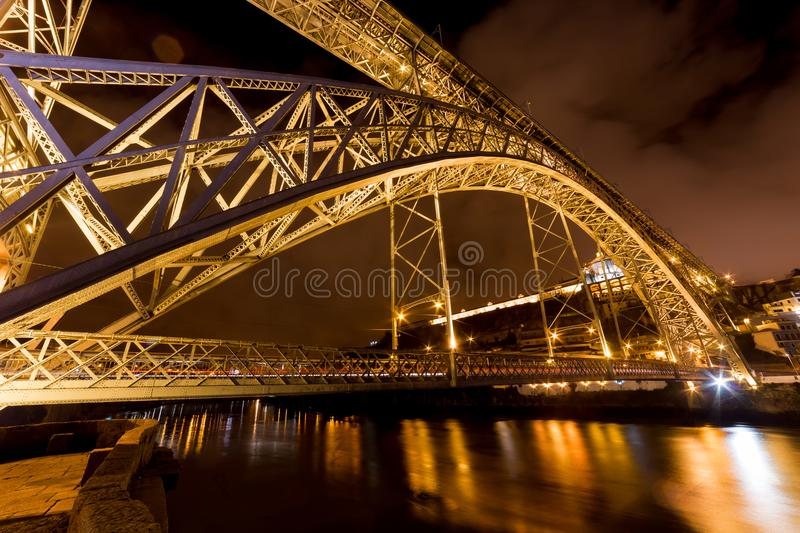The Dom Luis I Bridge at night, Porto, Portugal. The Dom Luis I Bridge at night, a metal arch bridge that spans the Douro River between the cities of Porto and stock photography