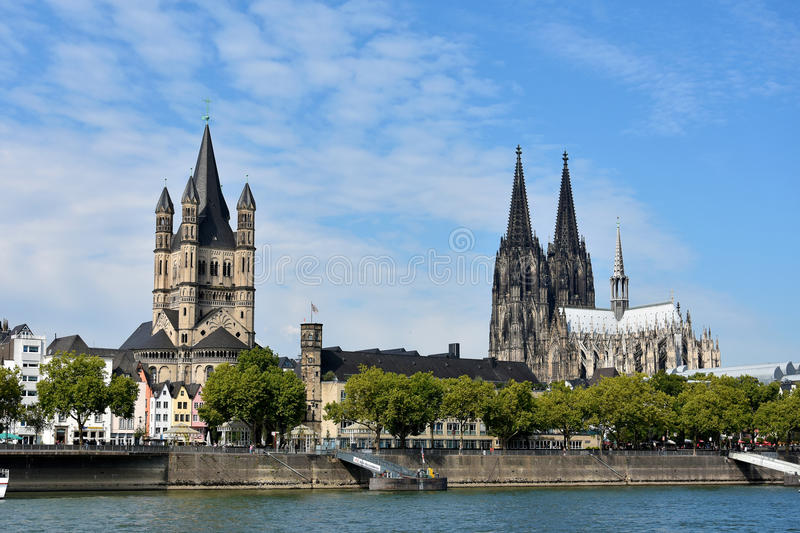 Cologne, churches and river Rhine. Dom and St. Martin church at the river banks of rhine in Cologne , Köln, in north rhine westphalia, Germany. The most royalty free stock photo