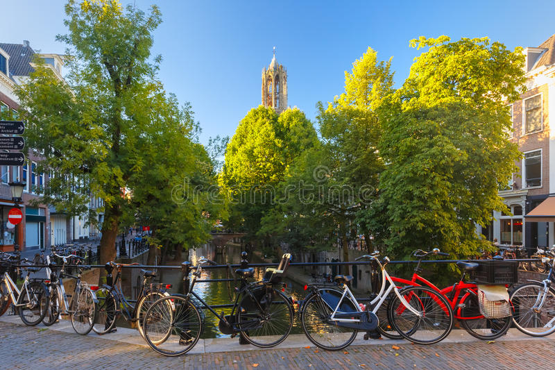 Dom Tower and bridge, Utrecht, Netherlands. Dom Tower, canal and bridge with bikes in the sunny evening, Utrecht, Netherlands stock photography