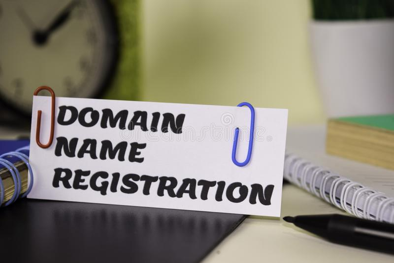 Domain Name Registration on the paper isolated on it desk. Business and inspiration concept royalty free stock photography
