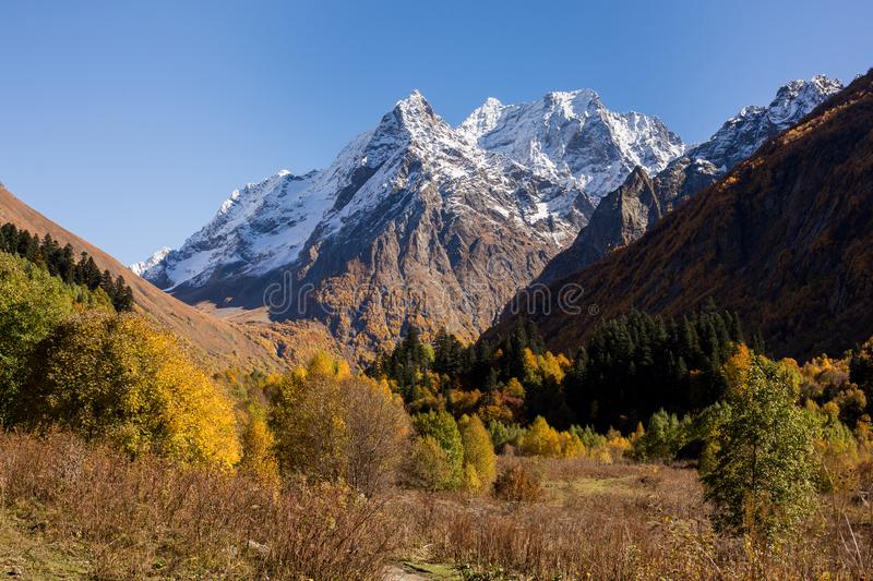 Dombay-Ulgen mountain and valley. At atumn in Dombay, Russia stock photography