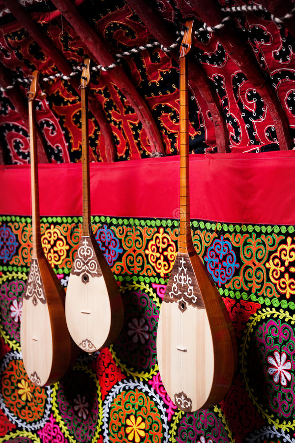 Dombra instrument in Kazakh yurt interior royalty free stock image