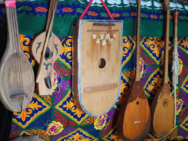 Dombra string instruments on the wall of Kazakh yurt royalty free stock photos