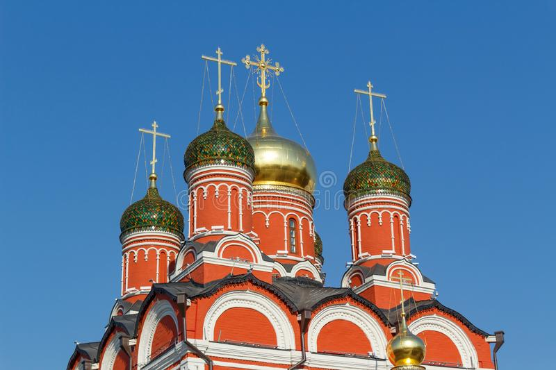 Dome of Cathedral of the icon of the Mother of God `Sign` closeup on a blue sky background. Sunny morning in Moscow stock photography