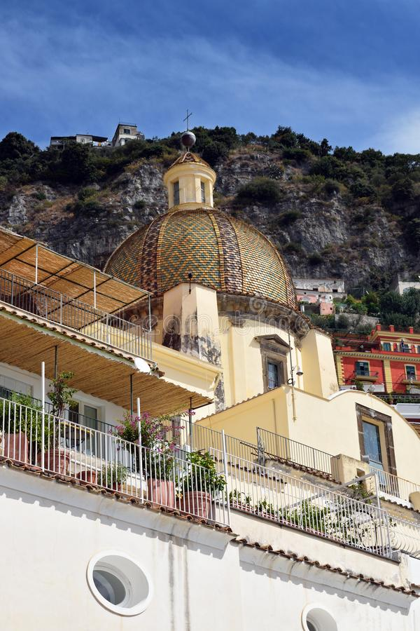 Positano church dome and hills. The dome of Chiesa di Santa Maria Assunta in front of a steep hillside, Positano, Italy royalty free stock photography