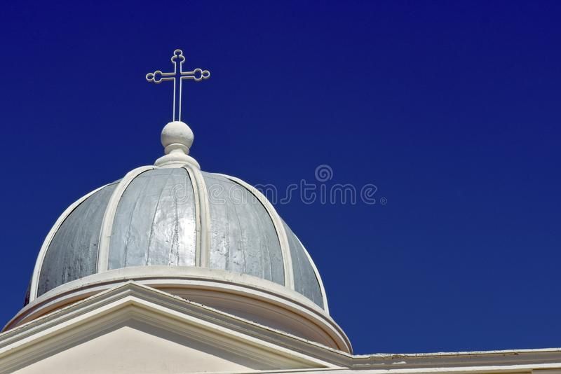 Dome church, with crucifix, under blue sky. Dome, with crucifix, of the Church and Sanctuary of Bom Jesus, under sky of intense blue without clouds. Itu, Sao stock images