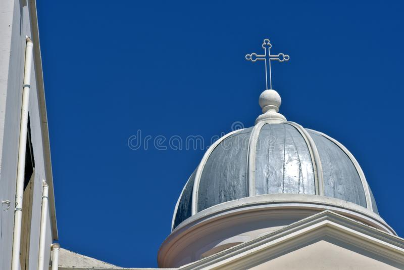 Dome church, with crucifix, under blue sky. Dome, with crucifix, of the Church and Sanctuary of Bom Jesus, under sky of intense blue without clouds. Itu, Sao royalty free stock photo