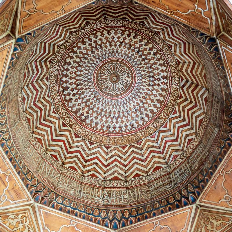 Dome decorated with colorful patterns at Mamluk era public historic Sultan Barquq Mosque, Cairo. Dome decorated with calligraphy and colorful floral and royalty free stock photos