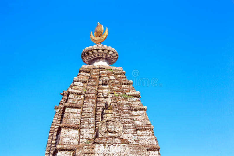 Dome Hindu Temple Blue Sky. Dome of a traditional Hindu temple on a background of blue sky. Himachal Pradesh, India stock photos