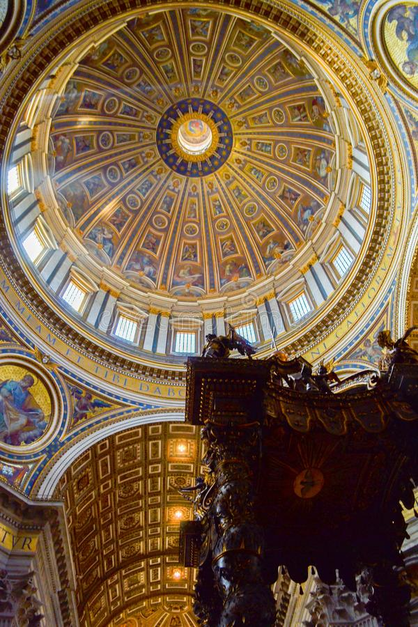 Dome inside of St. Peter`s Basilica with St. Peter`s Baldachin. Baldacchino di San Pietro, L`Altare di Bernini in the foreground, in Vatican City, Italy stock image