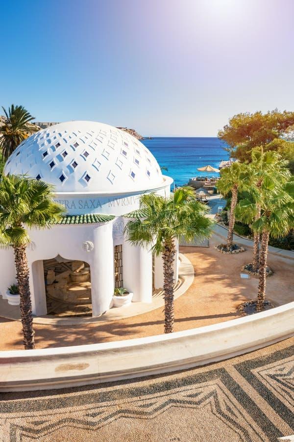 Dome in Kalithea Rhodes, Greece - Text translation:. `… through the rocks - Rumble now stock photos