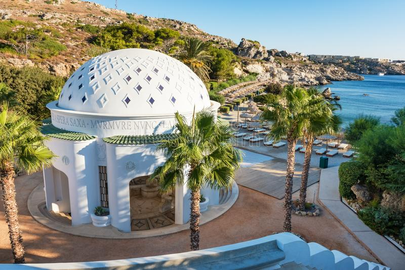 Dome in Kalithea Rhodes, Greece - Text translation:. `… through the rocks - Rumble now royalty free stock image