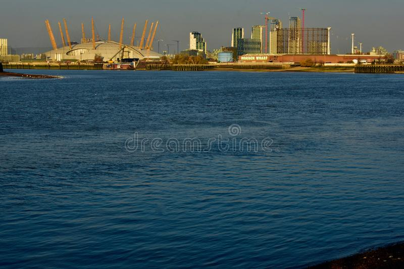 The dome of London O2 arena and the thames river royalty free stock image