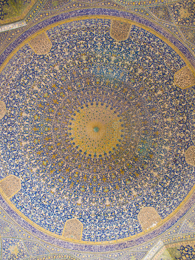 Dome of the mosque, oriental ornaments from Shah Mosque in Isfahan, Iran royalty free stock photo