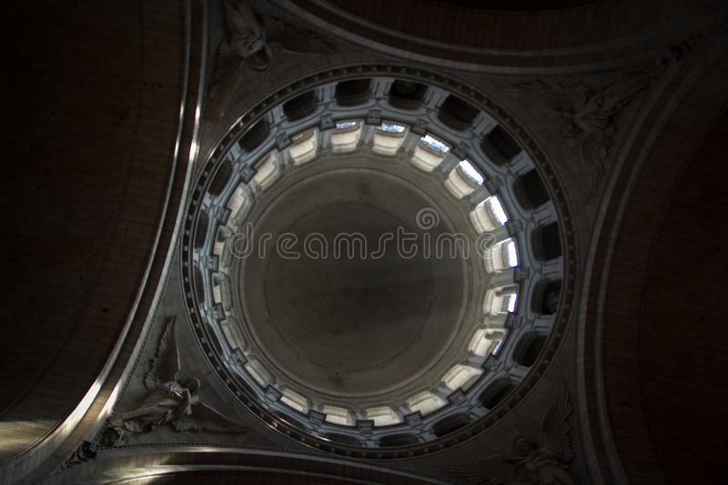 The dome of the old Catholic cathedral from the inside, the light makes its way through the stained glass windows. Light focus, free space for text stock image