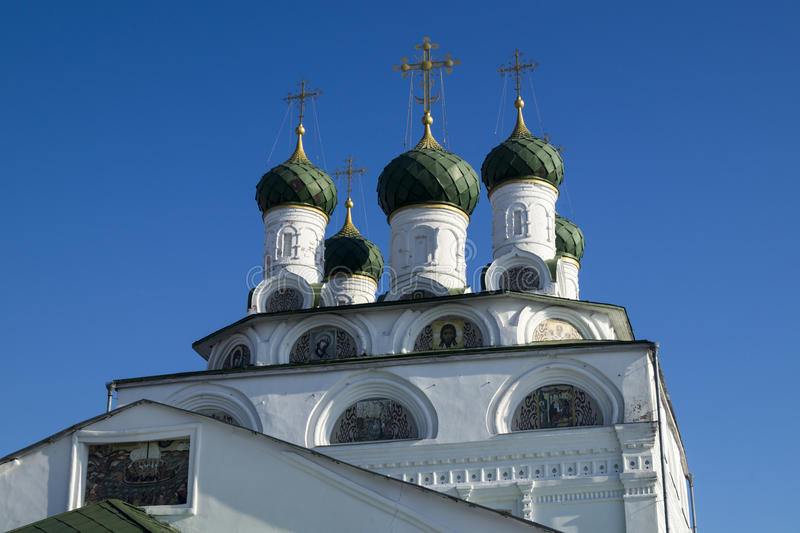 Dome and painting in niche Bogoyavlenskogo cathedral in city Mst. Green dome with cross and painting in niche Bogoyavlenskogo cathedral on background blue sky in stock image
