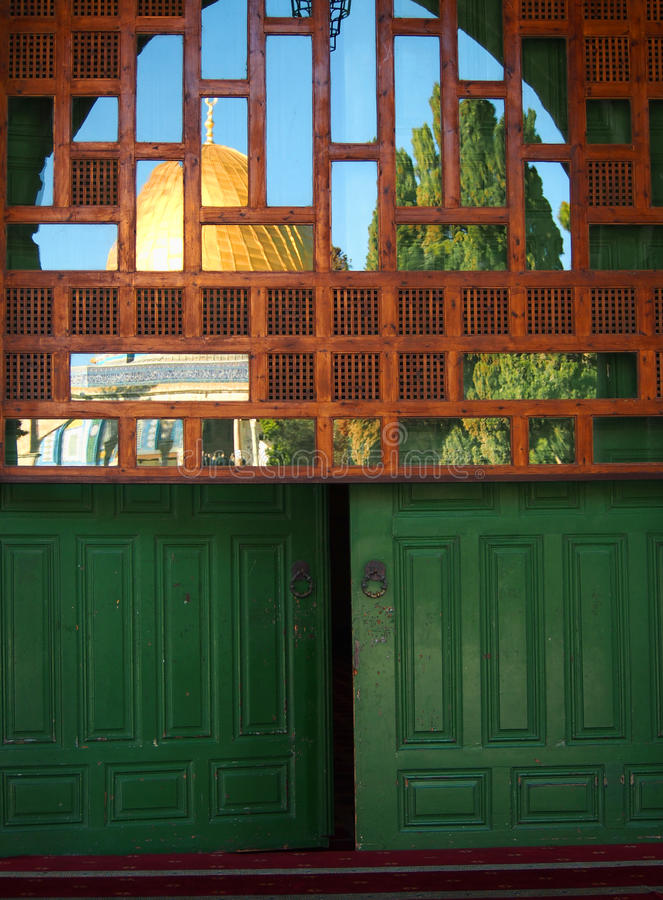 Dome of the Rock Mosque Reflected in Window royalty free stock photography