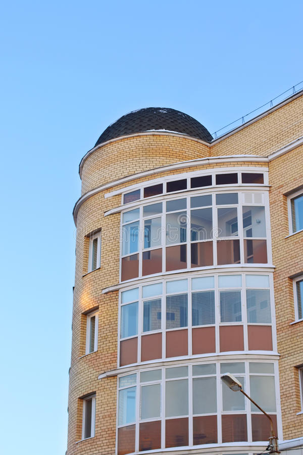Dome roof and balconies in apartment building. Of yellow brick stock images