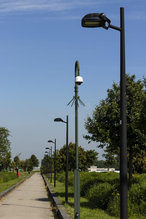 Security camera on a spiked pole in a park royalty free stock photos
