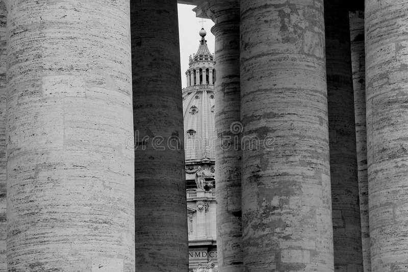 The dome of St. Peter's Cathedral seen through the colonnade royalty free stock photography