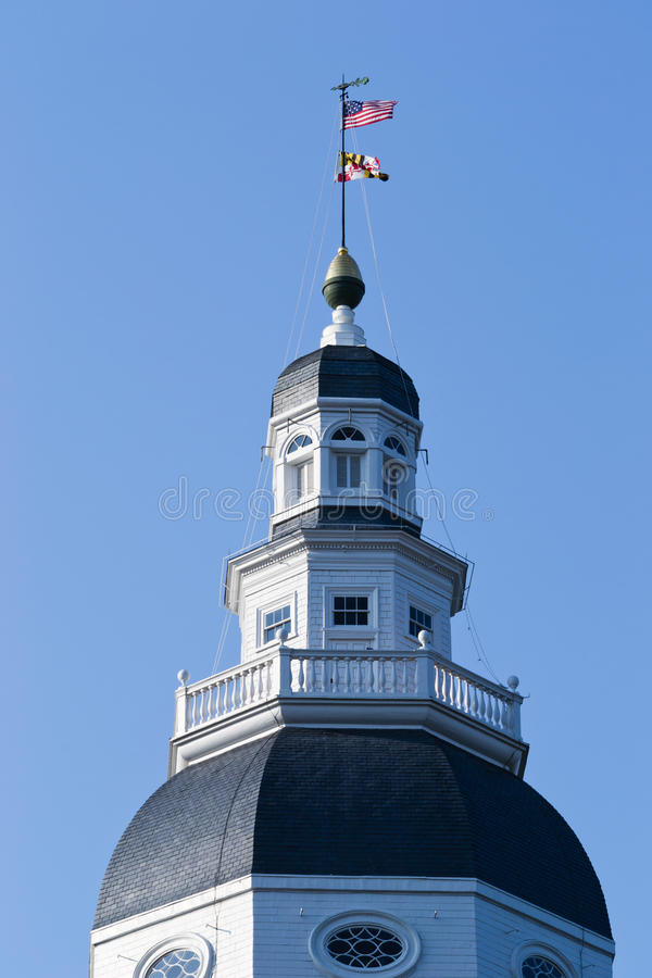 Dome & Star Spangled Banner. The wooden dome of the statehouse in Annapolis, Maryland USA, displaying the fifteen stars and stripes United States flag of the stock photography