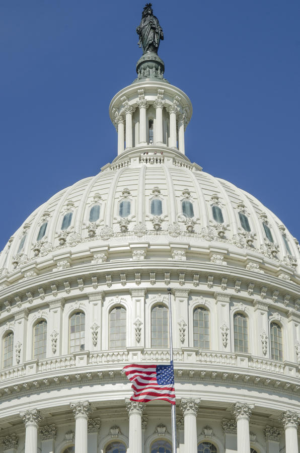 Dome of the United States Capitol Building with American flag stock photos