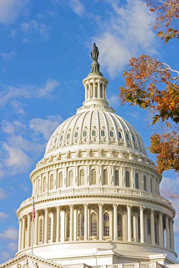 The dome of US Capitol building and colorful autumn tree foliage. royalty free stock photography