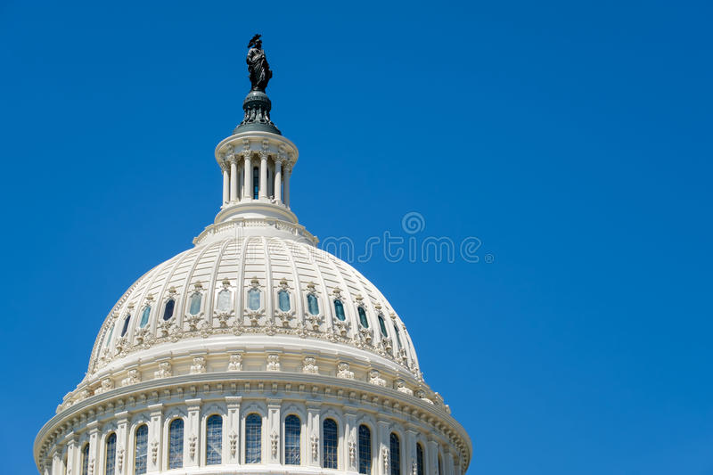 The dome of the US Capitol at Washington D.C. On a blue sky background stock image