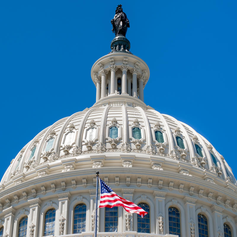 Dome of the Us Capitol at Washington with a United States Flag. Dome of the Us Capitol at Washington DC with a United States Flag stock photos