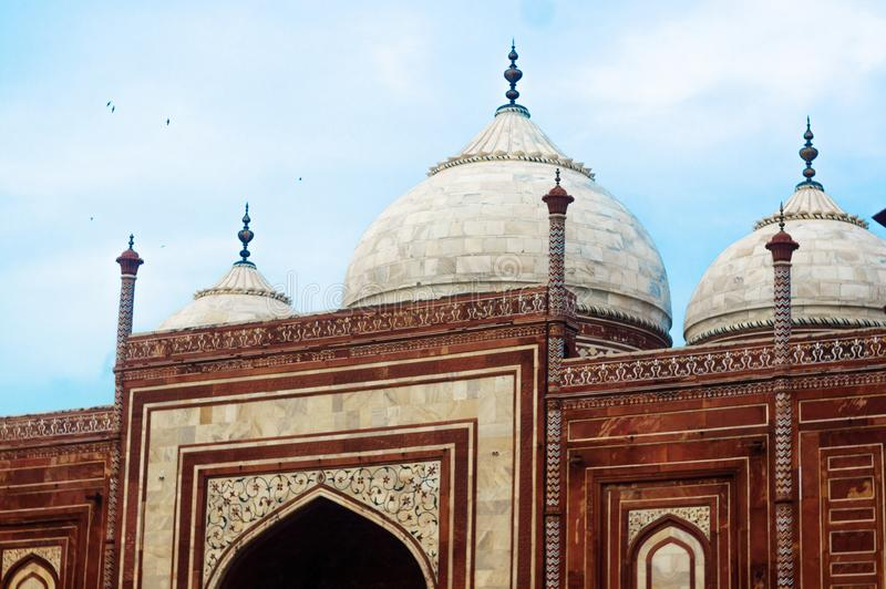 Domed roof, minarets against blue cloudy sky stock photography